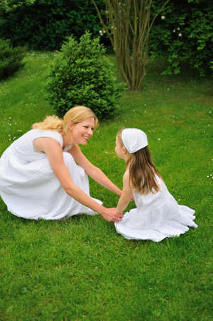 Young mother and daughter playing in meadow Stock Photo - 5994615