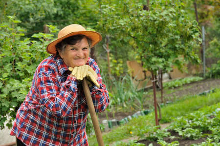 boater: Senior woman gardening