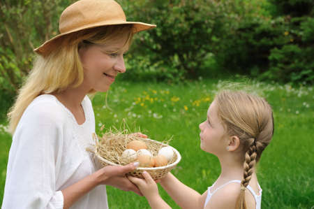 Mother and daughter having Easter time photo