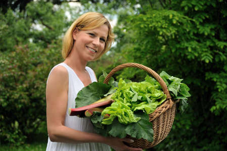 Young woman holding basket with vegetable Stock Photo - 6181255