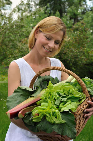 Young woman holding basket with vegetable Stock Photo - 6181259