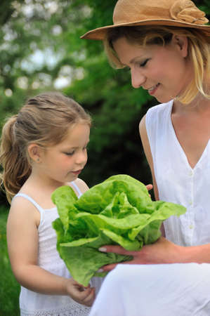 Young mother and daughter with lettuce Stock Photo - 6228085