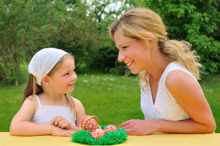 Young mother and daughter having Easter time photo