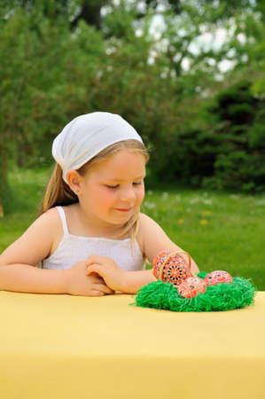 Little girl enjoying Easter time photo