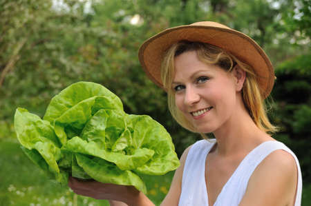 Young woman holding fresh lettuce Stock Photo - 6289565