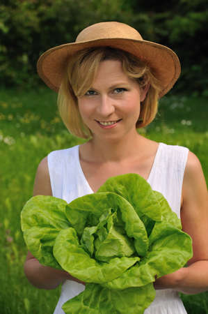 boater: Young woman holding fresh lettuce