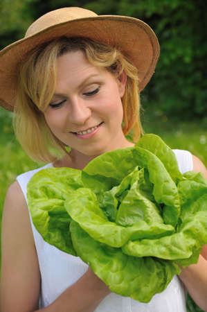 Young woman holding fresh lettuce Stock Photo - 6289568