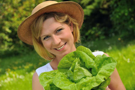 Young woman holding fresh lettuce Stock Photo - 6289566