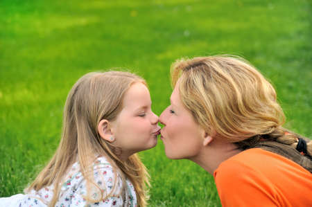 40 years: Mother is kissing her daughter