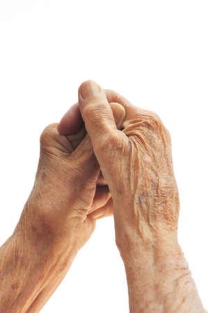 artritis: Manos de la mujer Senior aisladas en blanco