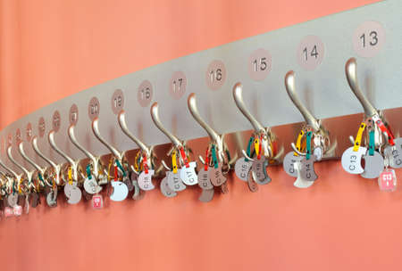 Coat hooks organized in a row photo