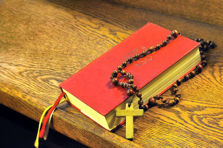 Hymnal  book and wooden rosary bead- detail photo