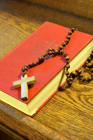 hymnal: Hymnal  book and wooden rosary bead- detail