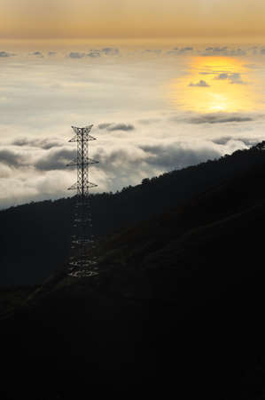 Electricity pylon over valley at sunset, Lomba das Torres,  Madeira island, Portugal photo