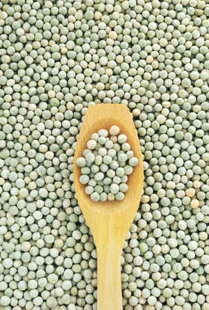 Wooden spoon and dried green split peas Stock Photo - 8411872