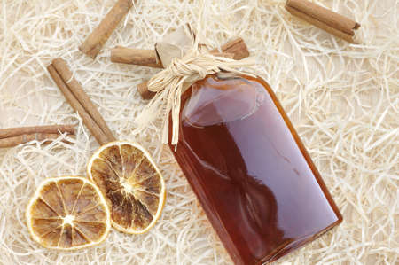 Homemade liqueur with spices - still life photo