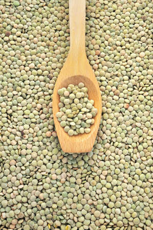 Wooden spoon and dried green lentils Stock Photo - 8438185