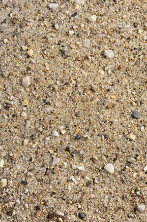 Detail of sand texture with small stones - background photo