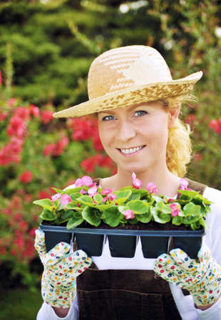 yard work: Woman with container-grown plants