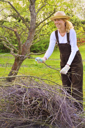 limbs: Young woman cleaning tree limbs Stock Photo