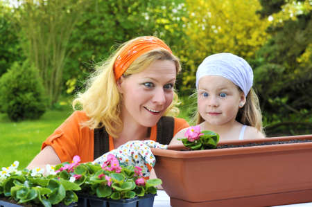 gardening gloves: Young mother and her daughter - gardening