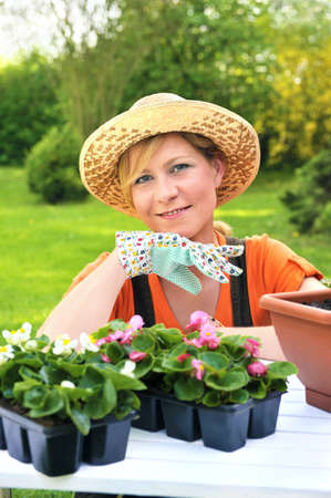 yard work: Young woman - gardening Stock Photo