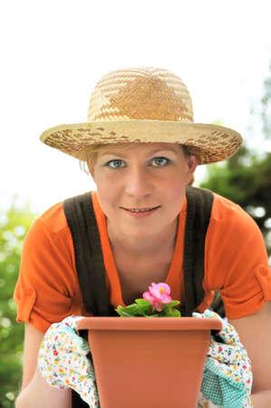 transplants: Young woman - gardening Stock Photo