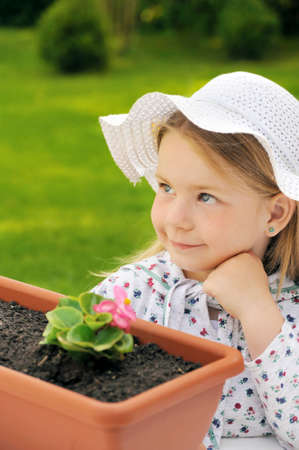 Little girl  - gardening Stock Photo - 8669633
