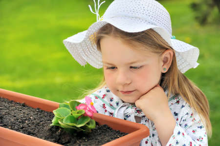 Little girl  - gardening photo