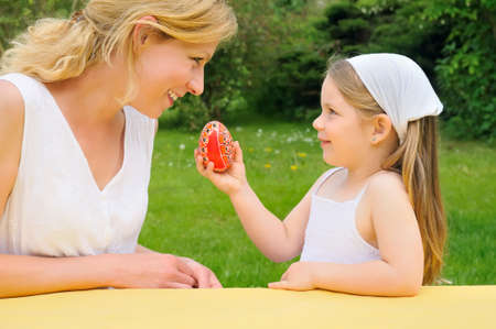 Young mother and daughter having Easter time Stock Photo