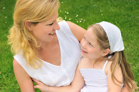 Portrait of young woman and her daughter - happy time Stock Photo - 8716498