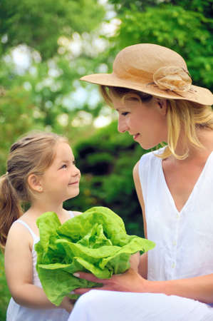 Young mother and daughter with lettuce Stock Photo - 8732516
