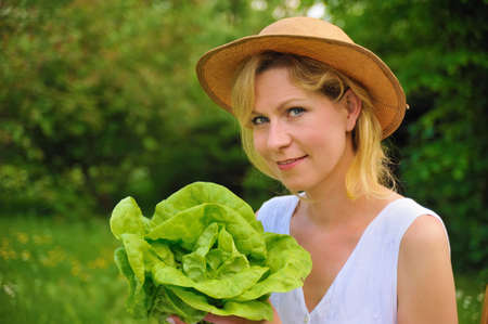 Young woman holding fresh lettuce Stock Photo - 8716544