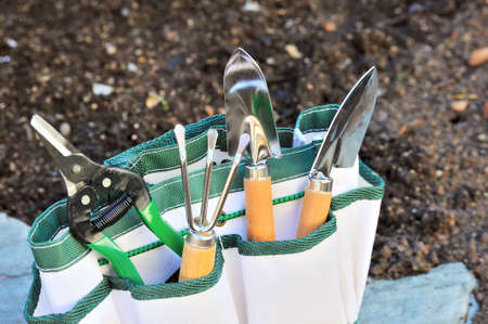 Detail of gardening tools in tool bag - outdoor photo