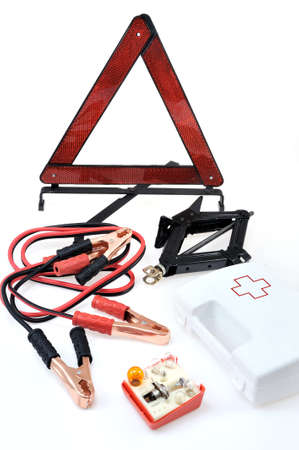 cable car: Emergency kit for car - first aid kit, car jack, jumper cables, warning triangle, light bulb kit Stock Photo