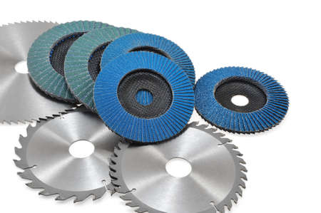 Circular saw blades and abrasive disks  isolated on white photo