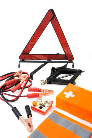 emergency kit: Emergency kit for car - first aid kit, car jack, jumper cables, warning triangle, light bulb kit Stock Photo