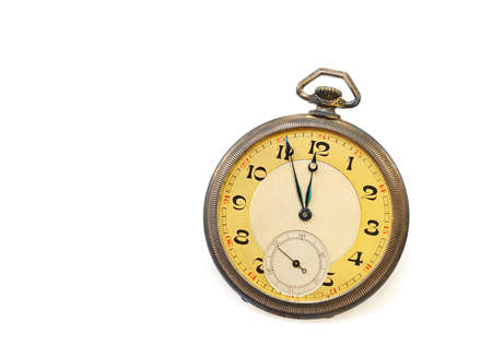 Old antique pocket watch isolated on white background photo