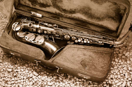 Saxophone in old leather case - still life photo