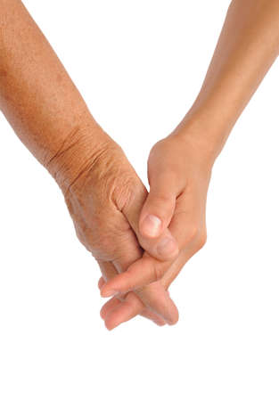 Hands of young and senior women - helping hand concept