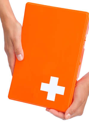first aid box: Hands of young woman holding first aid kit