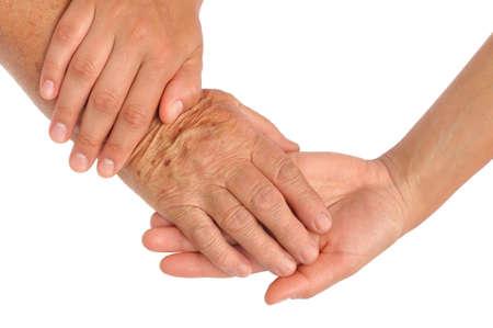 caring hands: Handen van jonge en senior vrouwen - helpende hand concept - uitknippad opgenomen