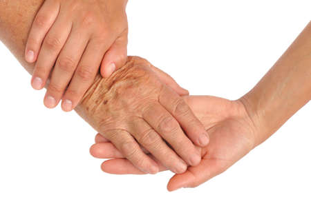 caring hands:  Hands of young and senior women - helping hand concept - clipping path included