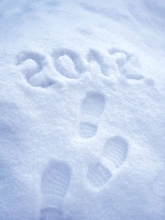 Foot step print in snow - New Year 2012 concept Stock Photo - 10835649