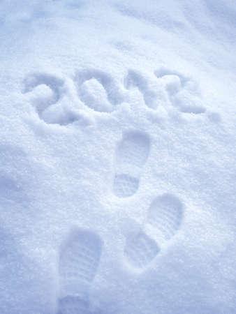 foot step: Passo impronta nella neve - Capodanno 2012 concetto