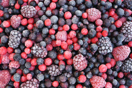 blackberry fruit: Close up of frozen mixed fruit  - berries - red currant, cranberry, raspberry, blackberry, bilberry, blueberry, black currant Stock Photo