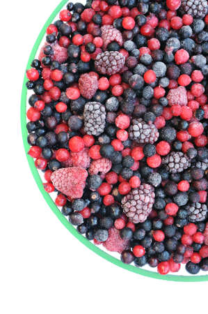Frozen mixed fruit in bowl - berries - red currant, cranberry, raspberry, blackberry, bilberry, blueberry, black currant Stock Photo