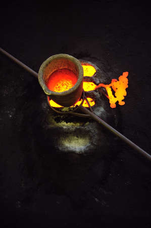 ferrous foundry: Foundry - molten metal in crucible standing on moulds - leftover