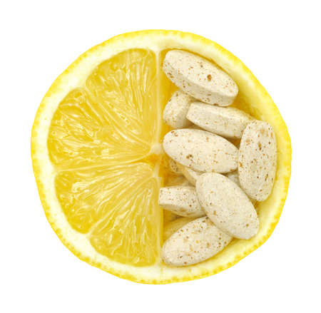 Close up of lemon and pills isolated – vitamin concept - vitamin c photo