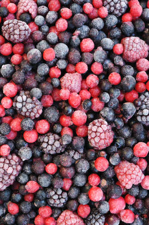 Close up of frozen mixed fruit  - berries - red currant, cranberry, raspberry, blackberry, bilberry, blueberry, black currant Standard-Bild